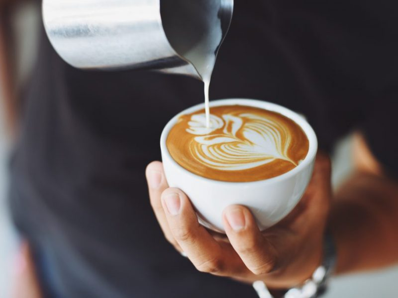 a man pours a cup of coffee