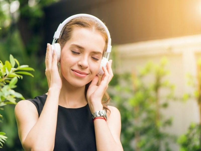 girl listening to chill-out music on headphones