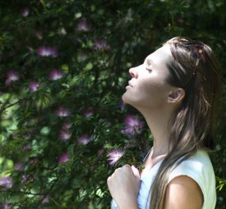woman breathing to reduce stress